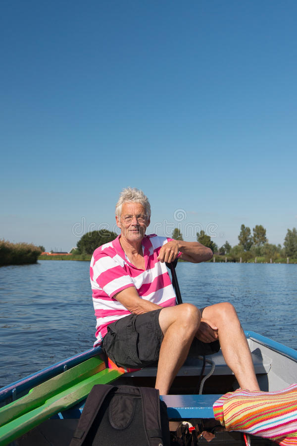 Download Man in boat at the river stock image. Image of shorts - 33487309