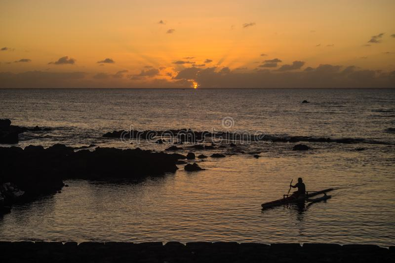 Man in a boat silhouette in Easter Island during the sunset Chile. Rapa nui stock image