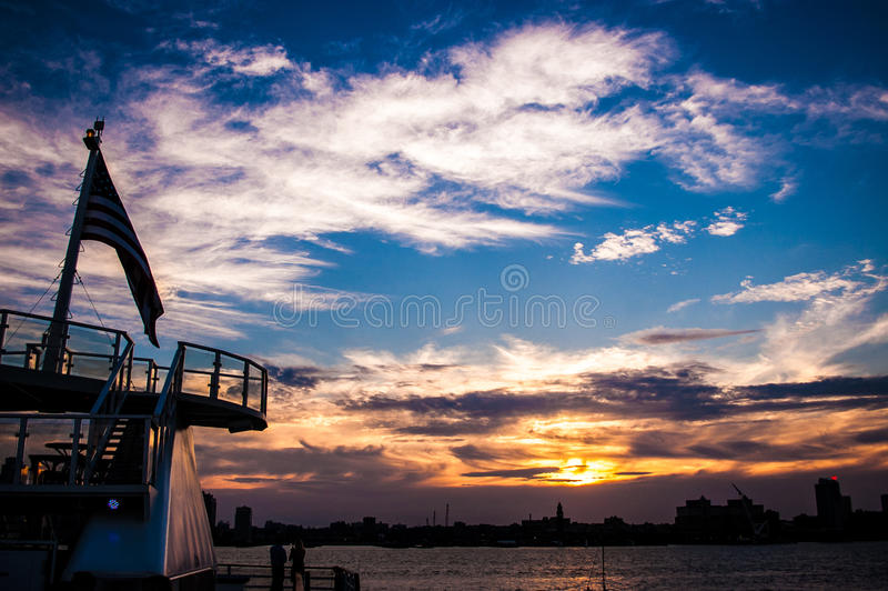 Man on a boat at sunset. Man relaxing on a boat at sunset on the Hudson River royalty free stock photos