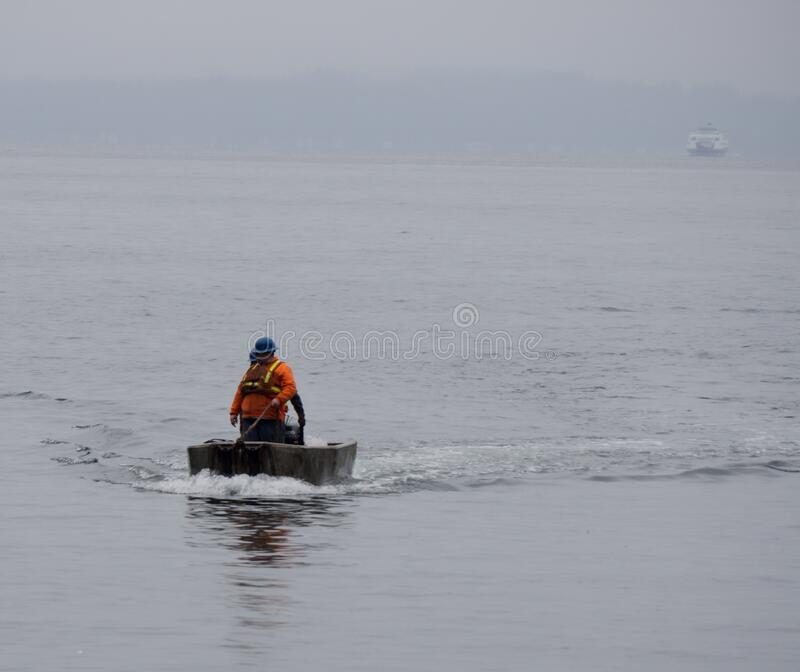 Man in boat on water royalty free stock images