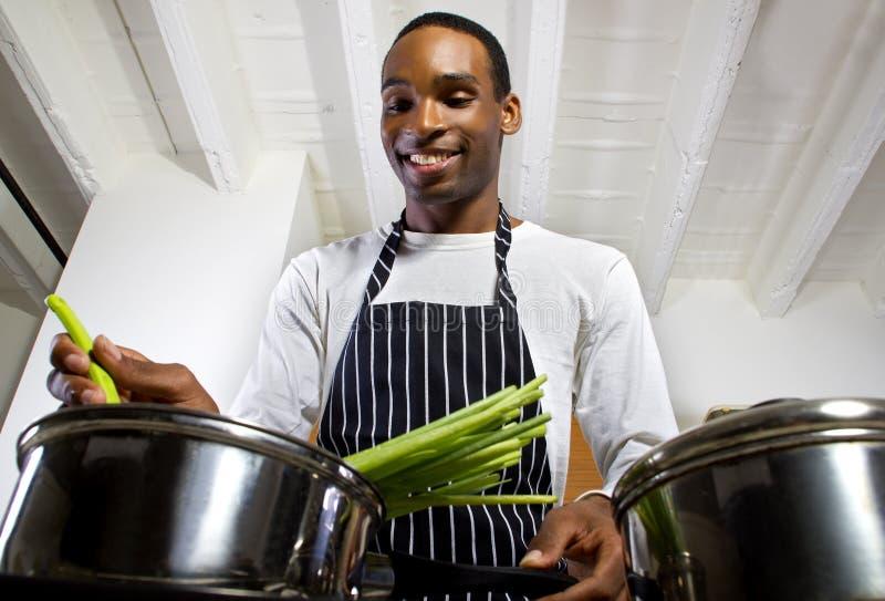 Man Boiling Vegetables stock image