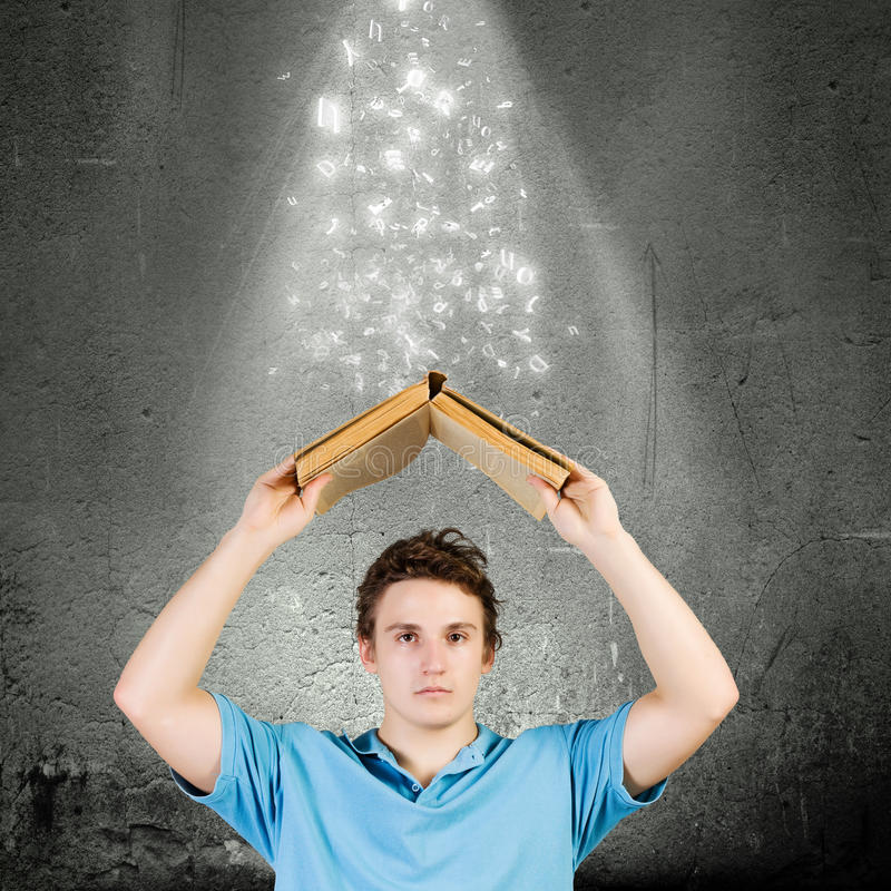 Man with book. Young man with opened book. Reading and education royalty free stock photography