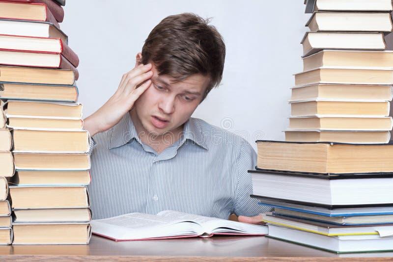 Man between books stock image
