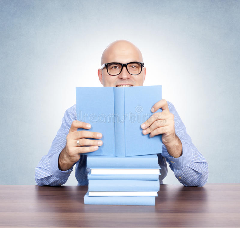 Download Man with the books stock image. Image of glasses, background - 27586173