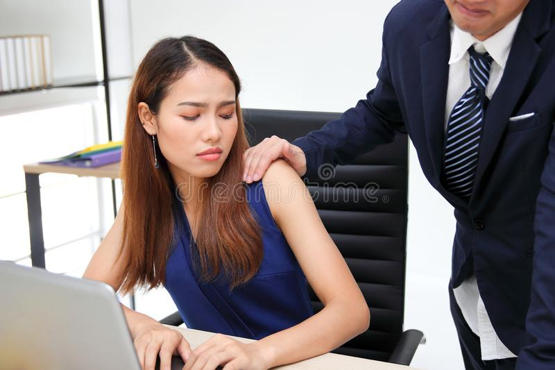 Man boss touching woman shoulder in workplace of office. Sexual harassment in office royalty free stock photos