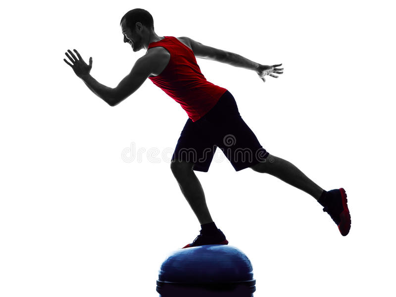 Man bosu balance trainer exercises fitness silhouette royalty free stock photography