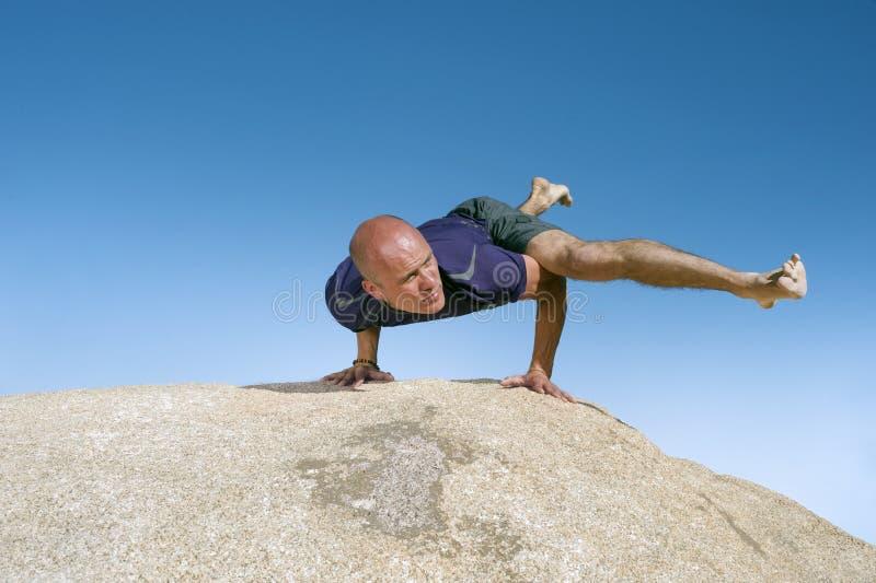 Man Yoga Eka Pada Koundinyasana II stock images