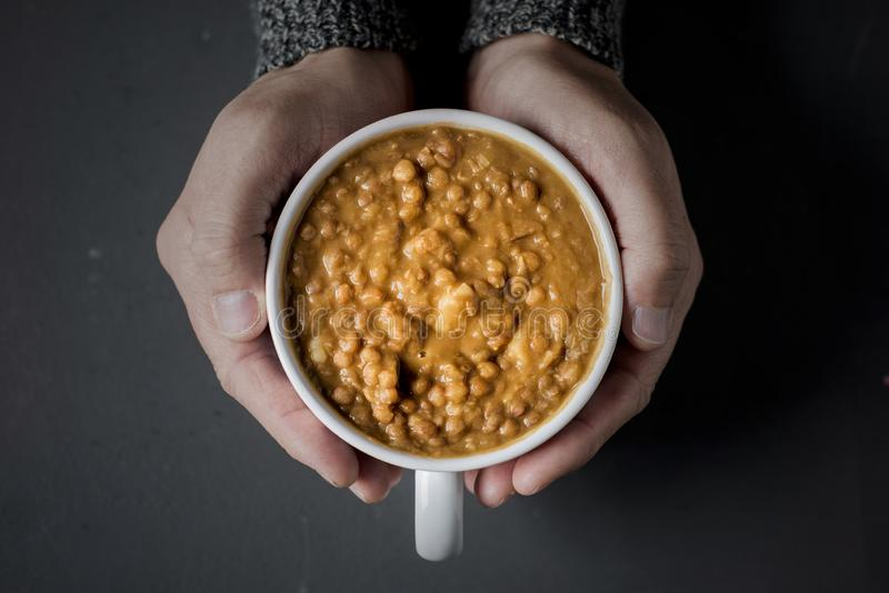 Man with a bowl of lentil soup stock image