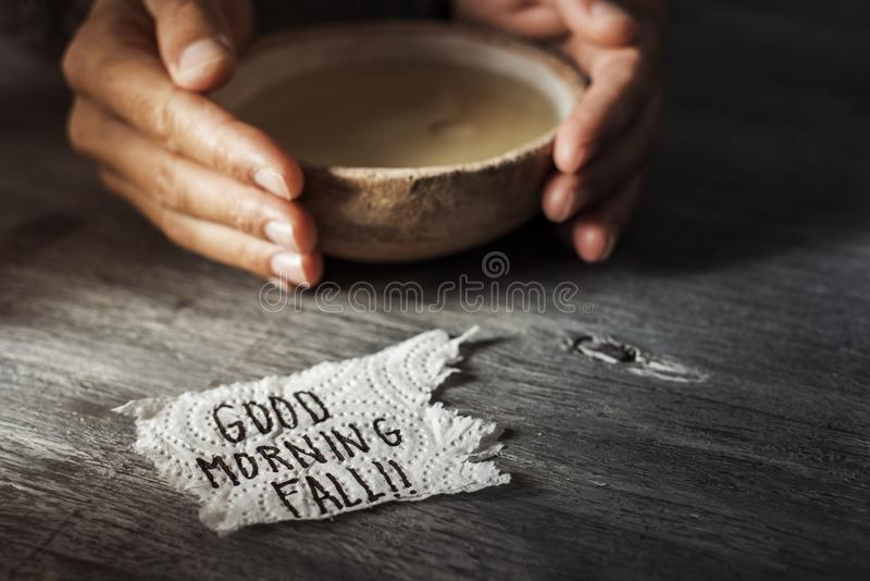 Man with a bowl of soup and text good morning fall royalty free stock photography