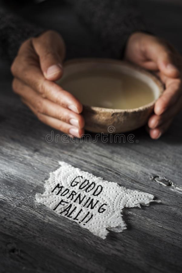 Man with a bowl of soup and text good morning fall royalty free stock images