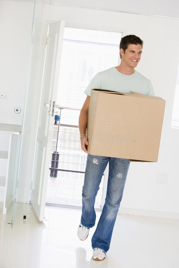 Download Man With Box Moving Into New Home Smiling Stock Image - Image: 5942569
