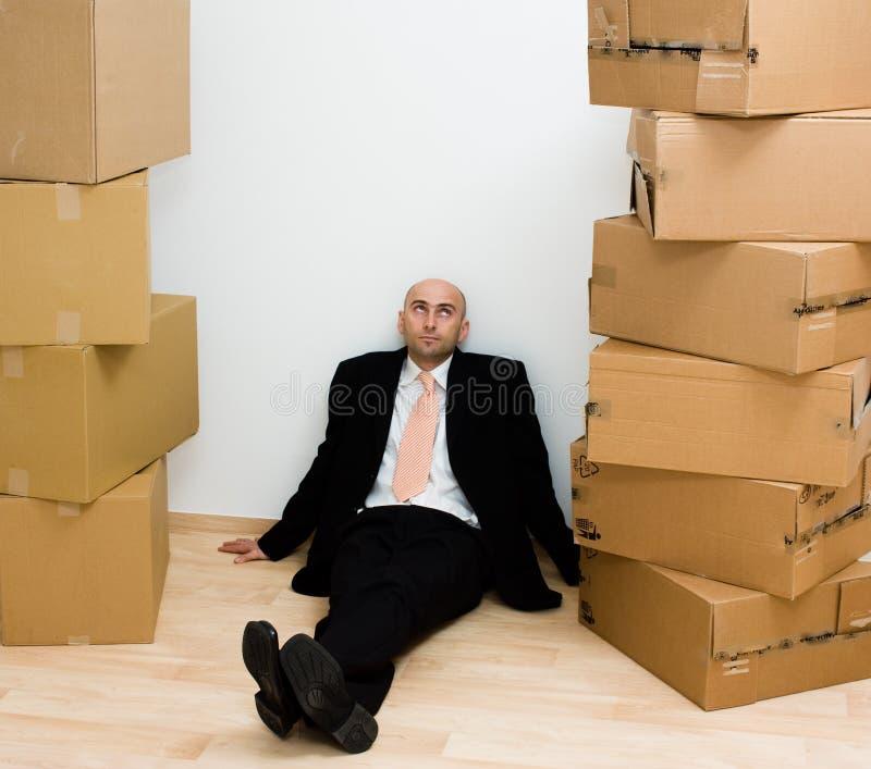 Man between boxes royalty free stock photos