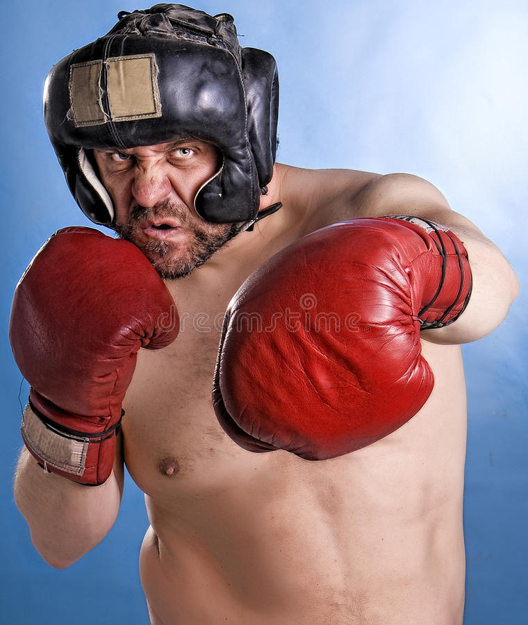 Man with boxing gloves. A man wearing boxing gloves stock image