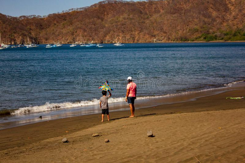 Man and Boy on Beach stock photo