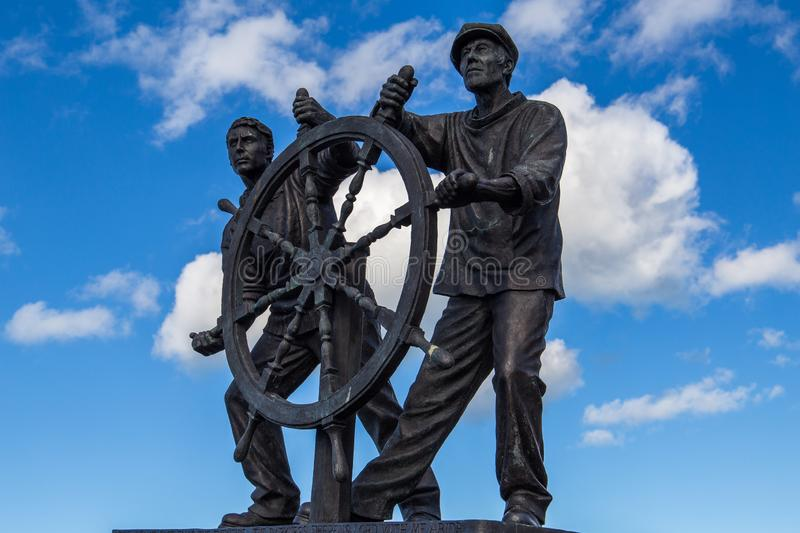 Man and Boy `The Wheel` statue royalty free stock photography