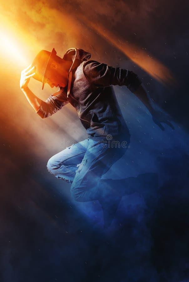 Man break dancing on smoke background royalty free stock image