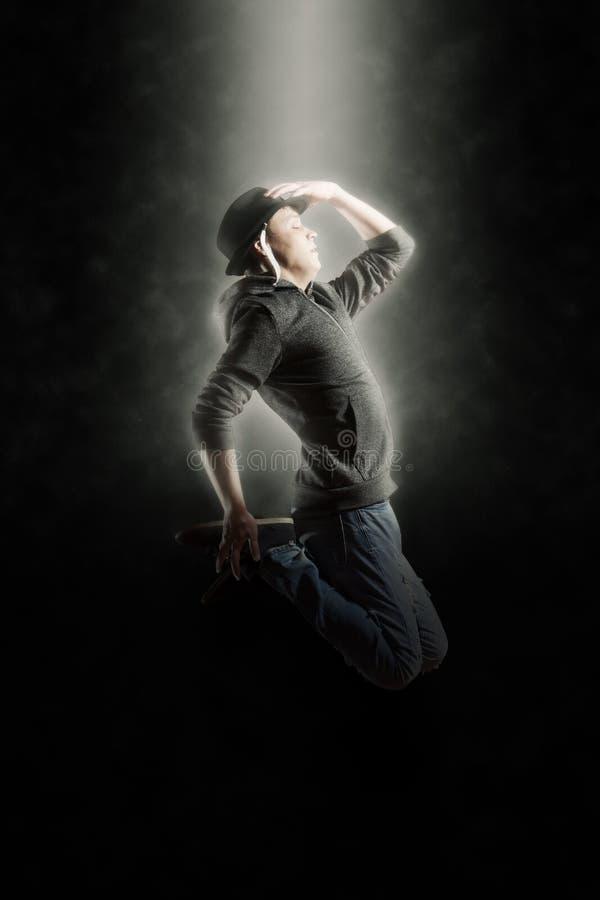 Man break dancing on smoke background royalty free stock photography