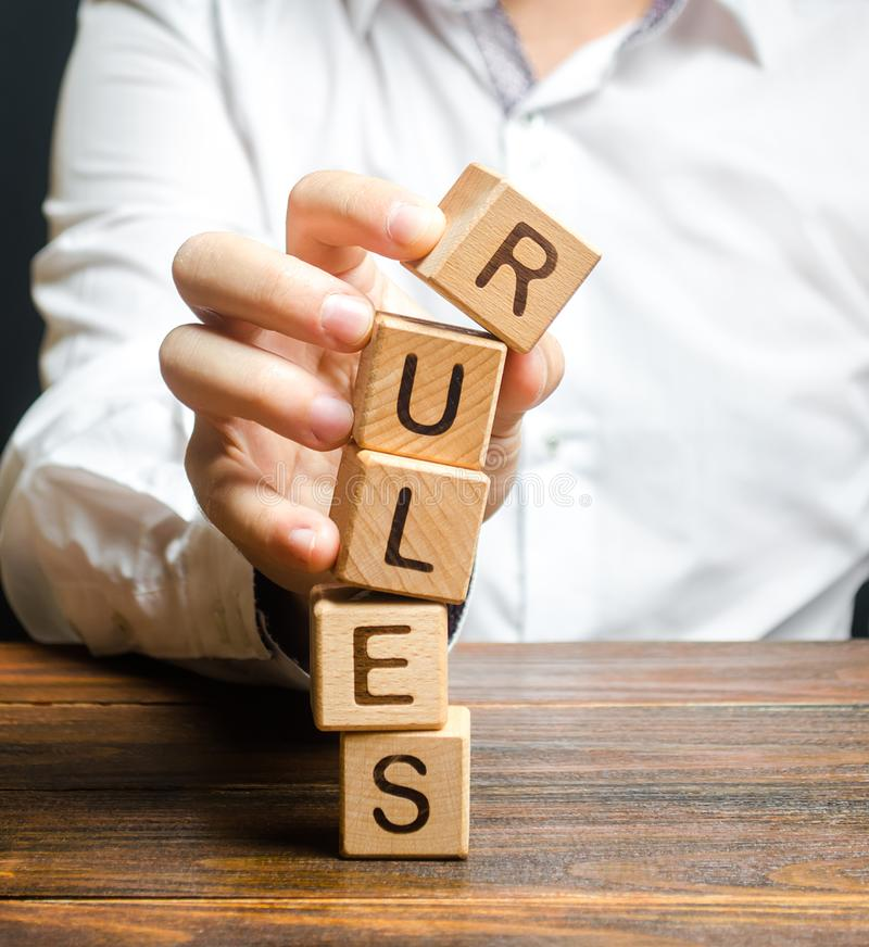 A man breaks the rules. Moral and ethical violations. Go against the law and system, non-recognition of the code of honor. Loopholes laws. Unreliable and stock image