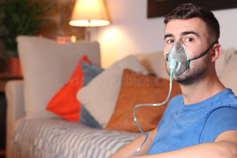 Man with breathing problems at home royalty free stock photos