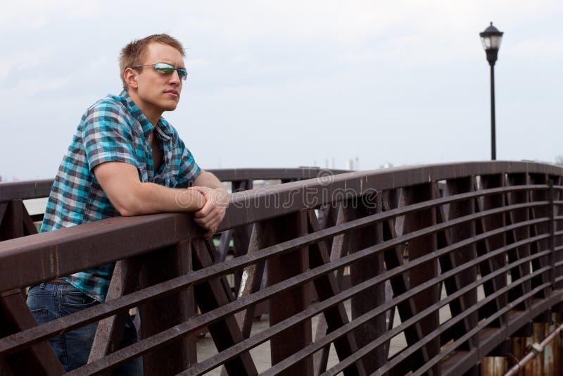 Man On Bridge Stock Photography