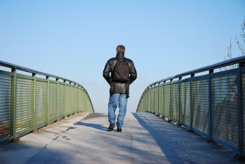 Man on bridge stock photo