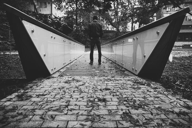 Man on a Bridge royalty free stock photos