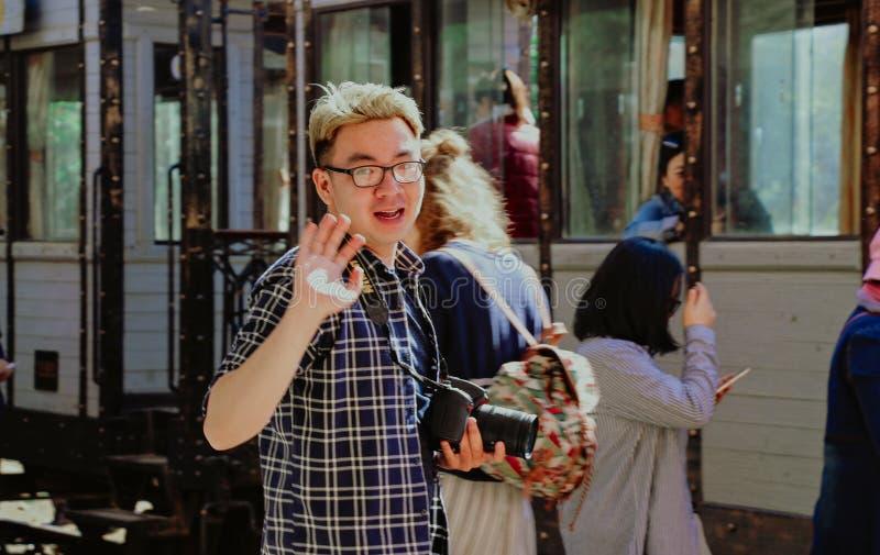 Man With Bridge Camera Waving royalty free stock image