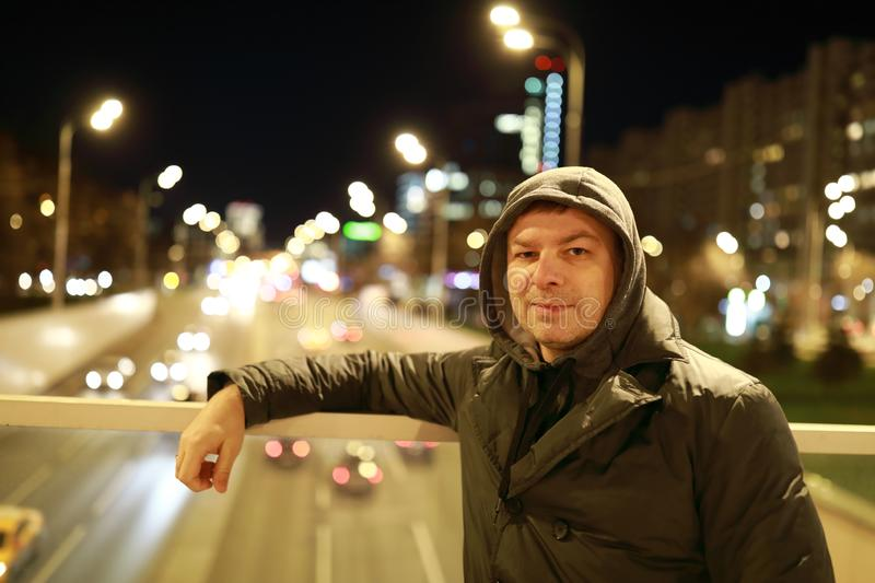 Man on bridge at night. In Moscow stock photography