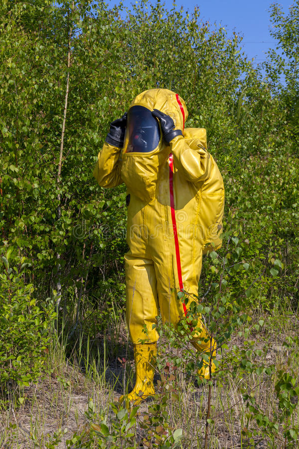 Man with briefcase in protective hazmat suit stock images
