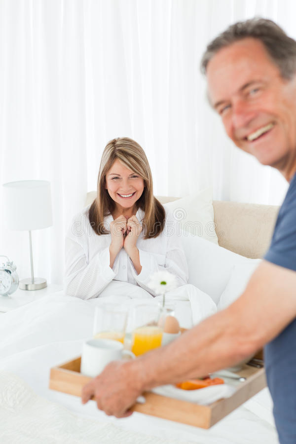 Download Man Bringing Breakfast To His Wife Stock Image - Image: 18109557