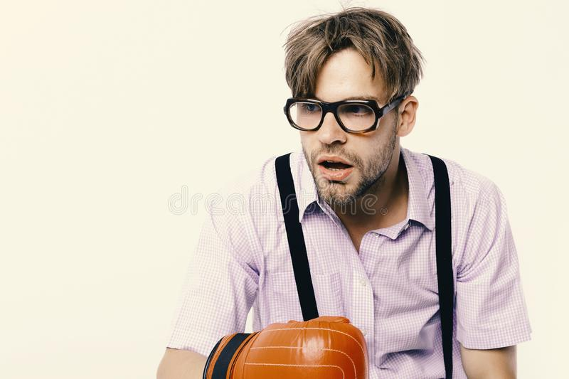 Man with bristle and dull face wears boxing gloves. royalty free stock photos