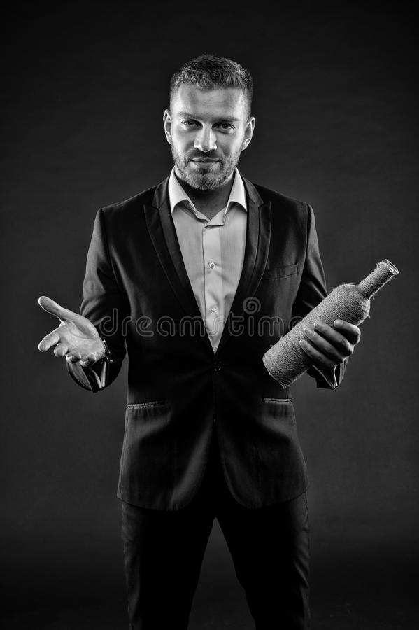 Man with bristle look calm and hospitably. Businessman or man in formal suit welcomes on dark background. Hospitality stock photos