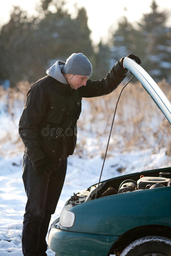 Download Man With Broken Car In Winter Royalty Free Stock Photo - Image: 12334035