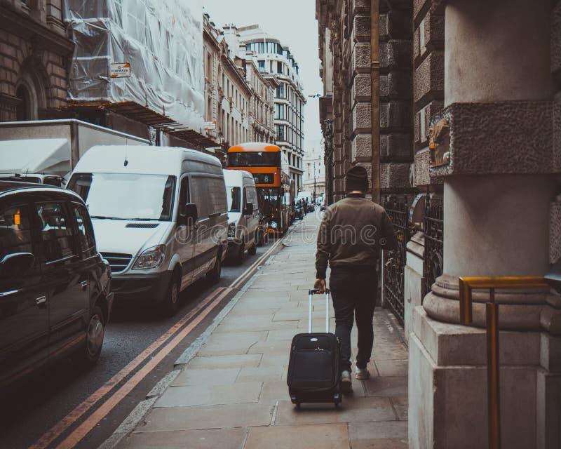 Man In Brown Jacket Holding Black Travel Luggage Dominio Público Y Gratuito Cc0 Imagen