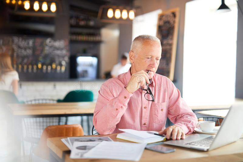 Man browsing in cafe royalty free stock photography