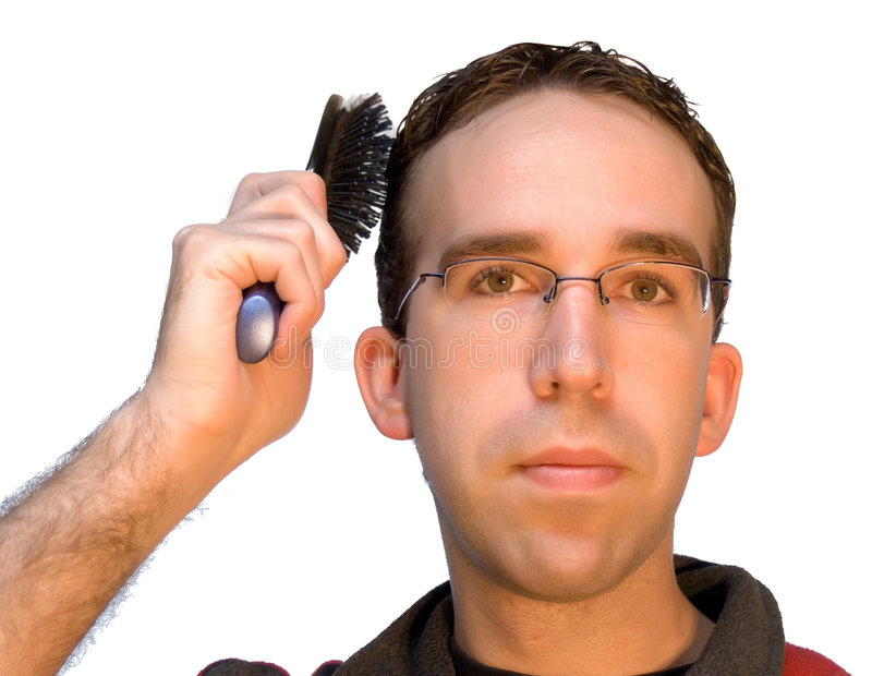 Download Man Brushing His Hair stock photo. Image of face, brush - 4586326