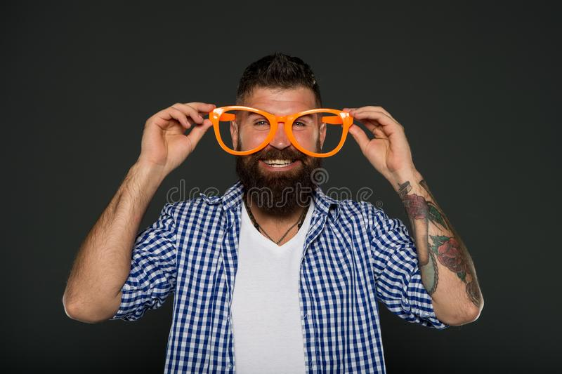Man brutal bearded hipster wear funny eyeglasses accessory. Human strengths and virtues. Positive mood. Positive stock images
