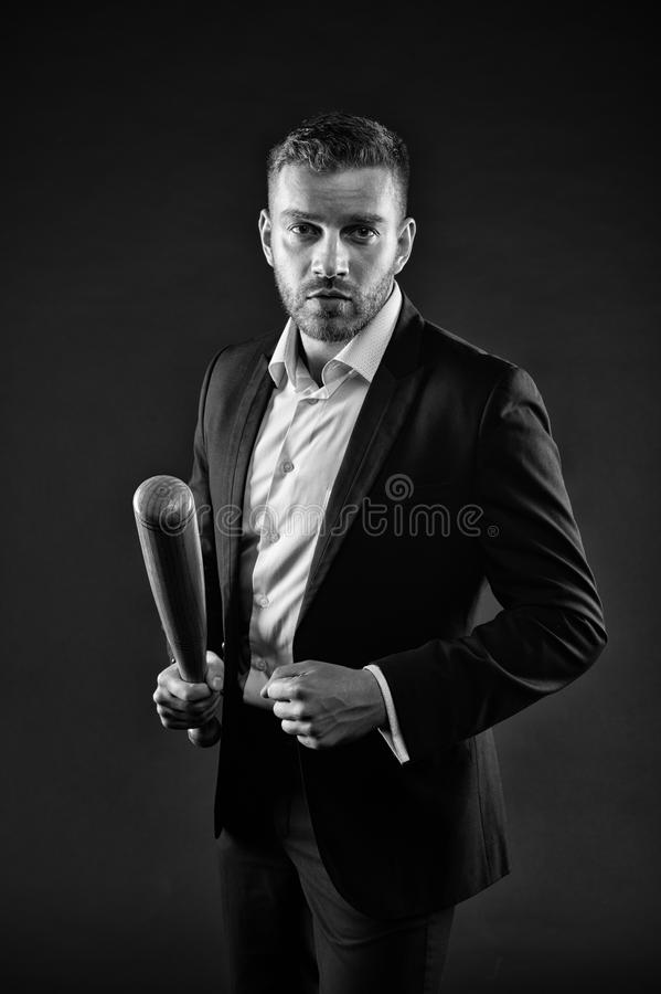 Man with brutal face holding baseball bat. Guy in suit isolated on black background. Fighter with confident look before stock photos