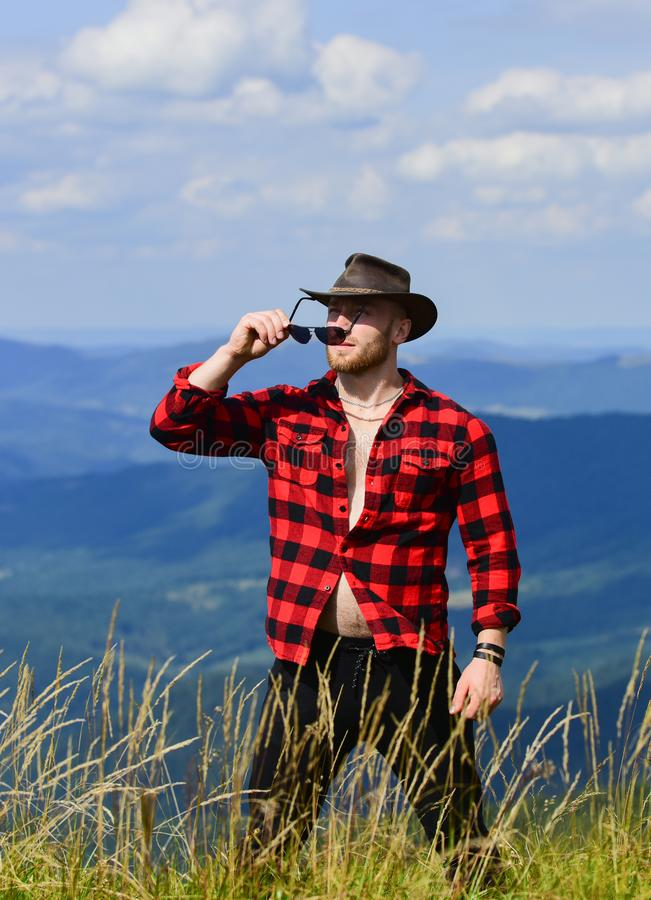 Man brutal ranger stand on top of mountain. Masculinity and energy of mountain. Mountain calling and i must go. Hiking. Concept. Active leisure. Manly guy enjoy royalty free stock photo