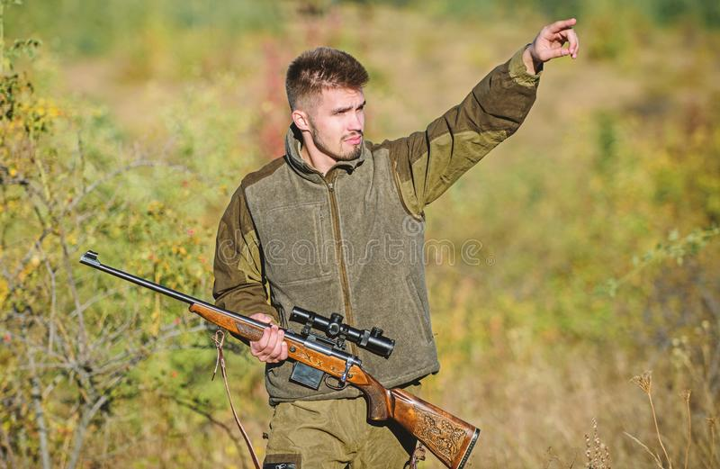 Man brutal unshaved gamekeeper nature background. Hunting permit. Hunter hold rifle. Hunting is brutal masculine hobby stock images
