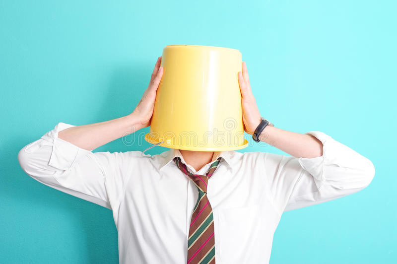 Man with bucket on his head stock image