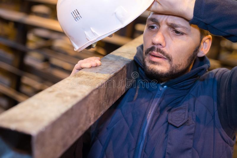 Man builder carrying wood. Man royalty free stock photography