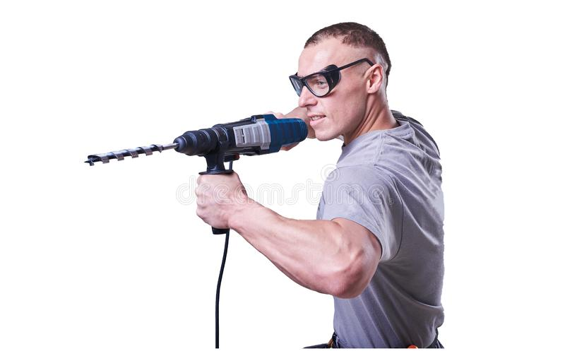Man, Builder, glasses, with a drill in hand isolated on white background. stock photography