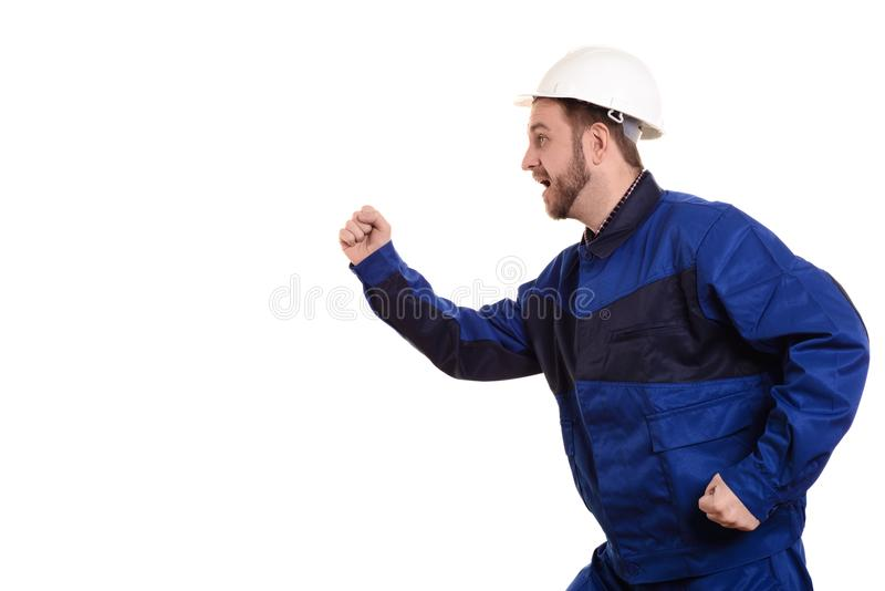 Man builder in hard hat and overalls runs for construction on the white background royalty free stock images