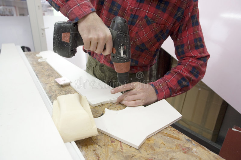 Man Building With A Drill Royalty Free Stock Images