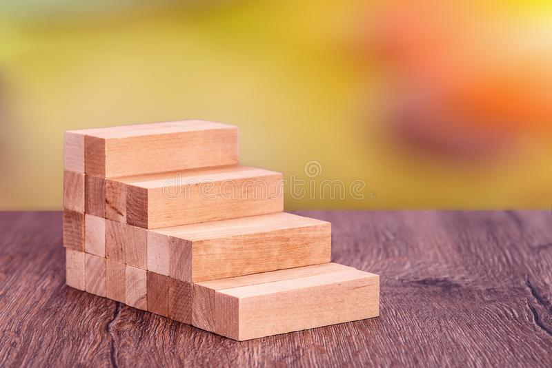 Man builds a wooden ladder. Concept: stable development stock photography