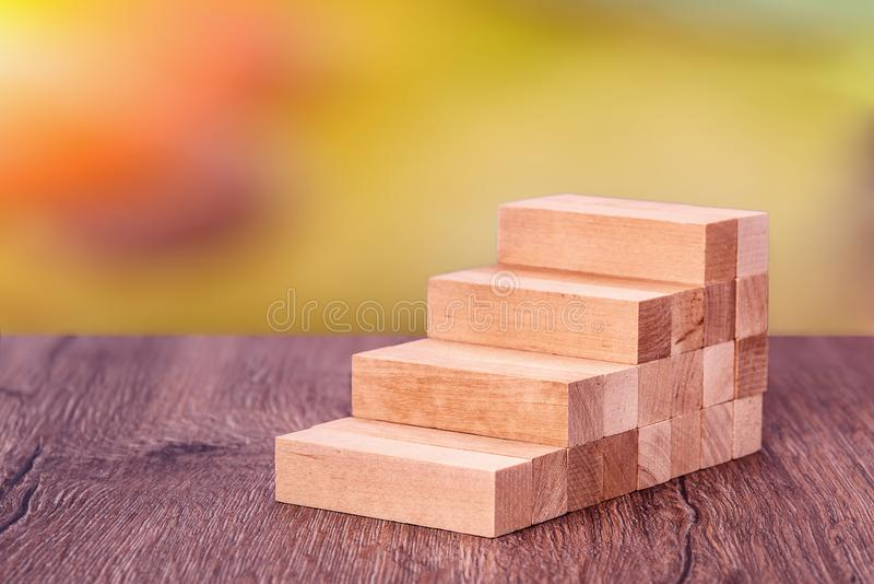 Man builds a wooden ladder. Concept: stable development royalty free stock photo