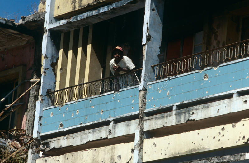A Man In A Bullet Riddled Building In Angola Editorial Image