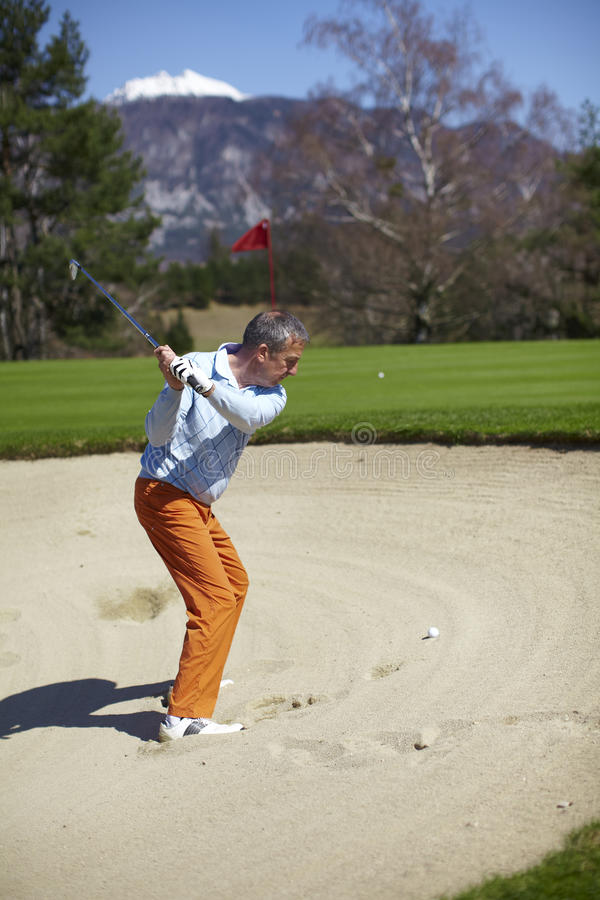 Download Man At The Bunker On A Golf Course Stock Image - Image: 14184087