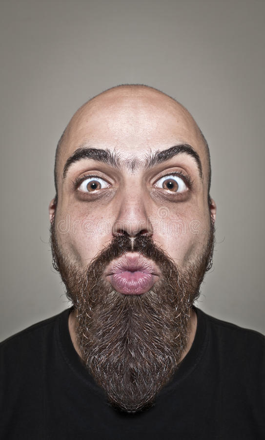 Download Man With A Bushy Beard That Blows A Kiss Stock Image - Image: 19896797